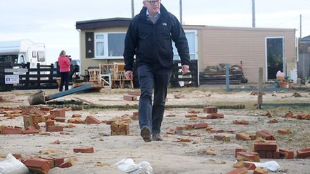 Floods. Norman Lamb MP visits Walcott to view the damage after the sea surges.PHOTO: ANTONY KELLY