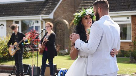 Emma Locke and fiancé Josh Leswell celebrate their lockdown wedding day with their neighbours on th