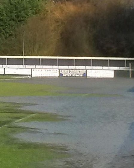 Photos of the waterlogged King's Marsh Stadium pitch posted on Twitter by AFC Sudbury on Sunday. Pic