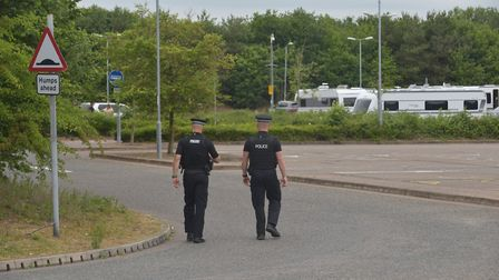 Police serving notice to large group of Travellers on Costessey park and ride. Pictures: Brittany Wo
