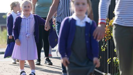 Parents drop off pupils at Queen's Hill Primary School, Costessey, after easing of lockdown measures