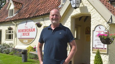 Proprietor Henry Watt outside The Honingham Buck which has reopened after lockdown Pictures: BRITTAN
