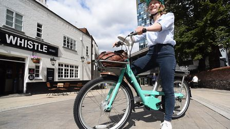 Reporter Sabrina Johnson trials one of the new electric Beryl bikes in the city. Picture: DENISE BRA