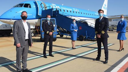From left, Norwich Airport managing director, Richard Pace; first officer, Stephan Mulder; cabin att