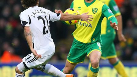 Norwich City midfielder Jonny Howson has had a full week's training after his long term back injury
