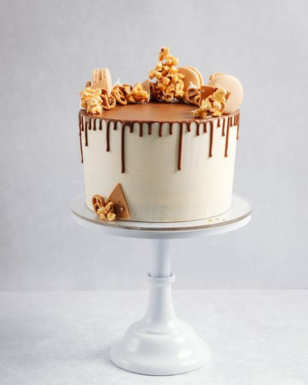 Caramel Crackle cake made up of four layers of vanilla sponge with salted caramel buttercream fillin