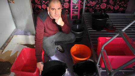 Penn Grove, Norwich resident Robert Fountain in the bedroom full of buckets that has been badly dama