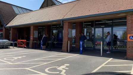 People adhering to the social distancing queue system at Tesco in Aylsham during the first lockdown.