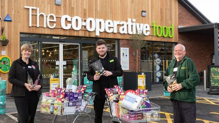 Store Manager Brad Tuckfield (centre) donated two trolleys worth of food and essentials to Cromer Fo
