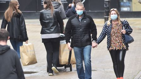 Shoppers in Norwich staying safe in face masks. Picture: Sonya Duncan