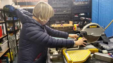 Sarah Babington at work in the couple's DIY garage factory. Picture: Noah Vickers