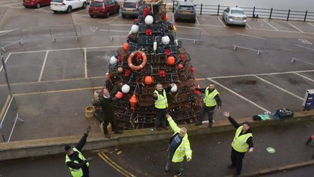 The Wells Christmas lights team with the crab pot Christmas tree, built by the local fishermen, at W