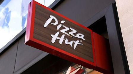Police are appealing for information after a Pizza Hut restaurant in Norfolk had its windows smashed