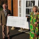 President of the Rotary Club of Norwich St Edmund, Malcolm Goodson, presenting a cheque for £1,600 t
