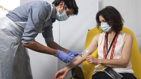 A volunteer is administered the coronavirus vaccine developed by AstraZeneca and Oxford University,