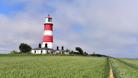 Happisburgh Lighthouse is painted in the traditional red and white colours. Picture: Nick Butcher