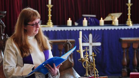 Revd Julie Oddy-Bates take the service at Kirby Cane church where 4 candles were lit to remember tho