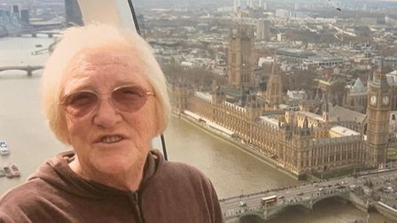 Elderly women in the London Eye overlooking the House of Commons.
