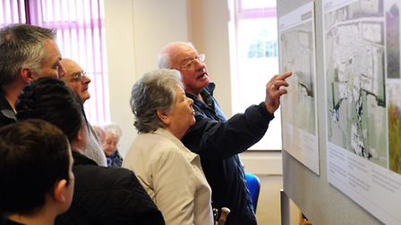 Visitors examine the proposals for the new homes development in Easton which were on show in the vil