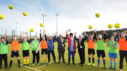 Sheringham's new multi-use games area. East Coast Warriors under 14s team members with, centre left