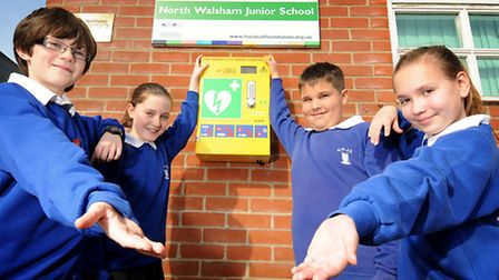 New defibrillator at North Walsham's Manor Road Schools. Pupils, left to right, George Penrose, 11,