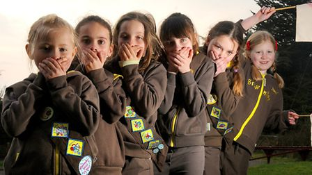 1st Cawston Brownies raise money for the EDP Flood Appeal by doing a sponsored silence. Left to righ