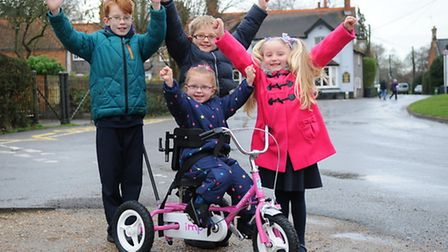 Felicity Wright pictured on her new trike with her brothers and sister, left to right, Ellie, 5, Jos
