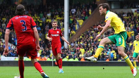 Jonny Howson scores Norwich City's fourth in last season's 4-0 win against West Brom at Carrow Road.