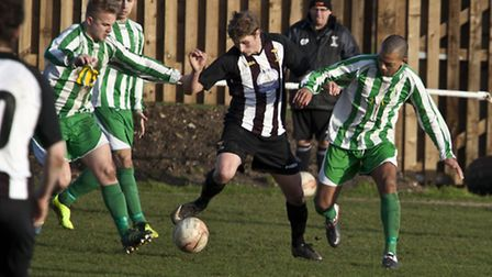 Joe Jackson on the ball for Swaffham Town. Picture: Eddie Deane.