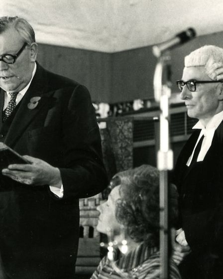 Sir Edmund Bacon, Lord Lieutenant of Norfolk, makes his declaration before signing the role of freem