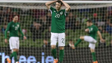Republic of Ireland's Wes Hoolahan reacts to Serbia's second goal during the international friendly