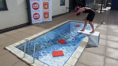 Jessica-Jane Applegate dives into a 3D pool drawn by artist Joe Hill at the University of East Angli