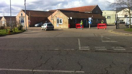 The scene outside Banham Poultry this afternoon following a crash which left one man in hospital wit