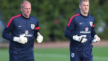 Norwich City goalkeeper John Ruddy has a fight on his hands to make England's World Cup squad. Pictu