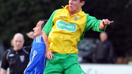 Wisbech Town's Jon Fairweather, right, in action for the Fenmen. Picture: Denise Bradley
