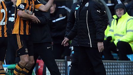 Newcastle United' manager Alan Pardew and David Meyler square up in the 'technical area'.