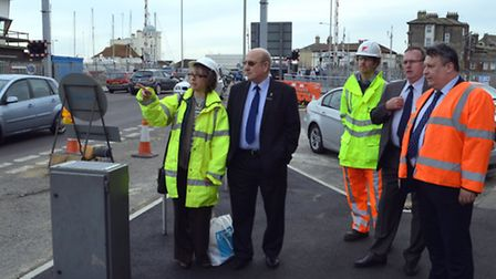Council leaders Mark Bee and Colin Law inspect the road problems Photo: Mick Howes