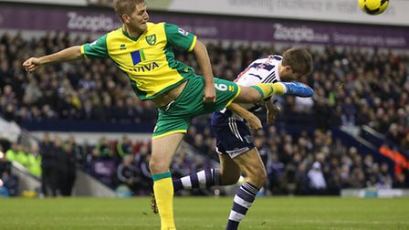 Michael Turner of Norwich and Gareth McAuley of West Brom during City's 2-0 win at The Hawthorns in