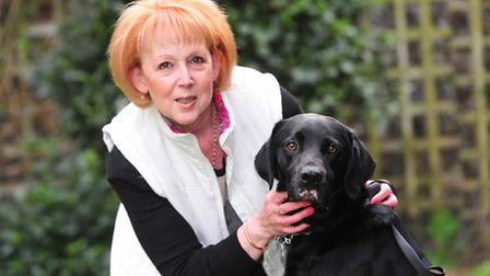 Mary Baker and her dog Ross. Ross, a four year old labrador, was bitten by an adder while walking o