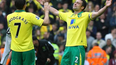 Norwich City players Russell Martin and Robert Snodgrass celebrate the 4-0 win against West Brom in
