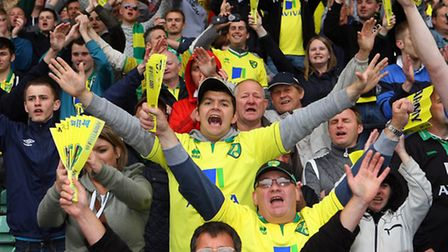 Norwich City fans celebrate City's 4-0 win against West Brom in their last home game of last season,