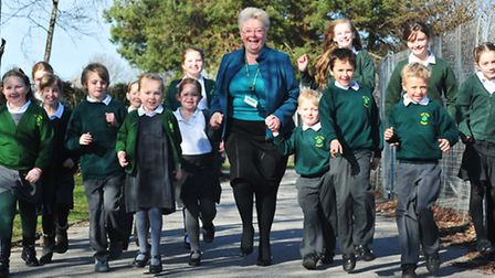ON THE UP: Elm Tree Primary School headteacher Hilary Day is joined by pupils as they celebrate an i