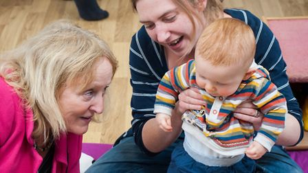 Raising Readers campaign gets under way in Norwich. Sheila Lock with Becky and baby Toby. Photo: Bil