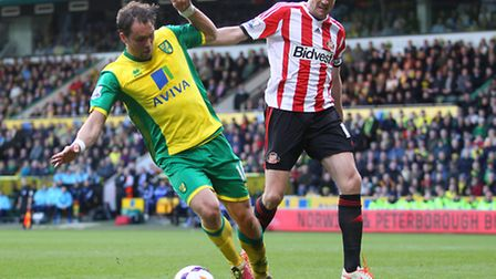 Johan Elmander of Norwich and John O'Shea of Sunderland in action during the Barclays Premier League