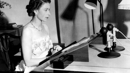 PA file photo dated 31/12/53 of Britain's Queen Elizabeth II making her Christmas broadcast to the