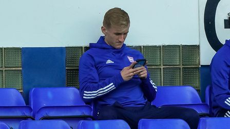 Flynn Downes in the stands for Ipswich Town's League One opener against Wigan. Photo: Steve Waller