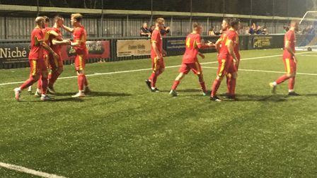 Needham Market players celebrate after Ben Fowkes breaks the deadlock with the opening goal. Picture