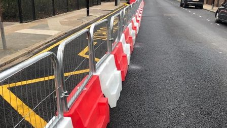 Temporary barrier at Woolmore Primary in Poplar while preparations are laid out to stop cars parking