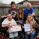 Julie Bellotti from Brandon with her family after winning Brandon Mum of the Year from Tesco.L-r Tom