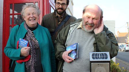 Keith Skipper tries out one of the Overstrand Undersong listening posts, watched Belfry Arts Centre